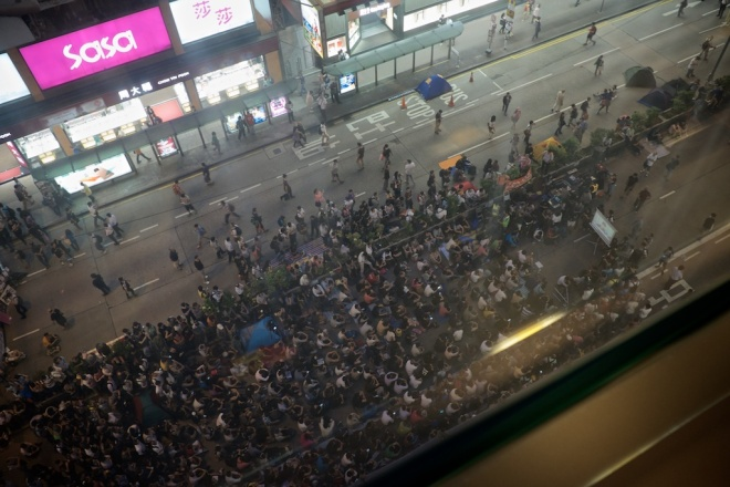 A projector screen has been setup on  Nathan road for all to watch.
