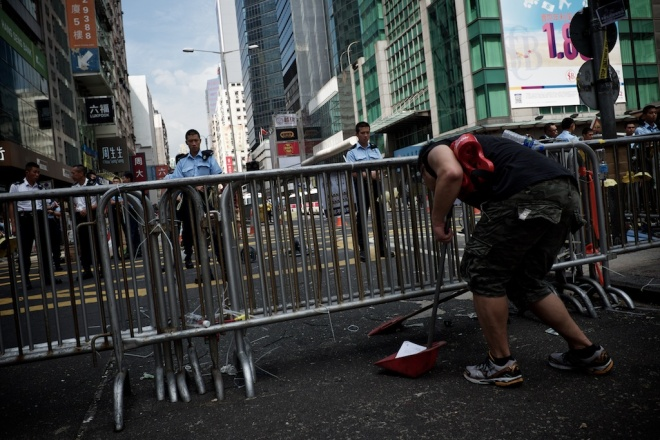 Occupy protesters take their occupation seriously, so much so they clean up the areas they have claimed for their protest sites.